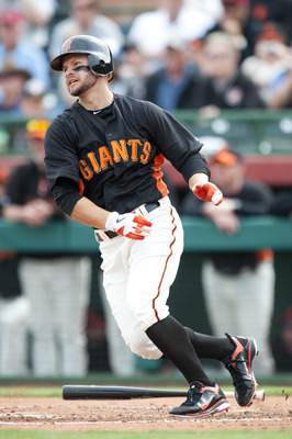 SCOTTSDALE, AZ - FEBRUARY 25: Cody Ross #13 of the San Francisco Giants bats during a spring training game against the Arizona Diamondbacks at Scottsdale Stadium on February 25, 2011 in Scottsdale, Arizona. (Photo by Rob Tringali/Getty Images)