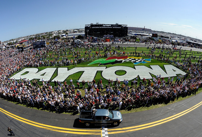 DAYTONA BEACH, FL - FEBRUARY 20:  Dale Earnhardt Jr., driver of the #88 National Guard/AMP Energy Chevrolet, rides past fans in a pickup truck during pre-race ceremonies for the NASCAR Sprint Cup Series Daytona 500 at Daytona International Speedway on Feb