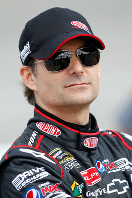RICHMOND, VA - APRIL 29:  Jeff Gordon, driver of the #24 DuPont Chevrolet, stands on pit road during qualifying for the NASCAR Sprint Cup Series Crown Royal Presents The Matthew & Daniel Hansen 400 at Richmond International Raceway on April 29, 2011 in Ri