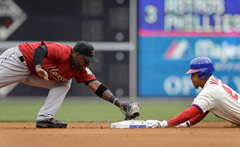 PHILADELPHIA, PA - APRIL 01: Second baseman Bill Hall #22 of the Houston Astros applies the late tag as Wilson Valdez #21 of the Philadelphia Phillies slides safely into the bag for a double during the third ininng at Citizens Bank Park on April 1, 2011 i