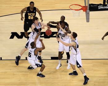 HOUSTON, TX - APRIL 02:  Rob Brandenberg #23 of the Virginia Commonwealth Rams fights for the ball against Ronald Nored #5, Andrew Smith #44, Matt Howard #54 and Shelvin Mack #1 of the Butler Bulldogs during the National Semifinal game of the 2011 NCAA Di