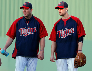 FORT MYERS, FL - FEBRUARY 27:  (L - R) Infielder Jim Thome #25 and first baseman Justin Morneau #33 of the Minnesota Twins talk just before the start of the Grapefruit League Spring Training Game against the Boston Red Sox at Hammond Stadium on February 2