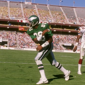1988:  Wide receiver Cris Carter of the Philadelphia Eagles celebrate a touchdown by spiking the ball in the end zone during a game against the Phoenix Cardinals at Sun Devil Stadium in Tempe, Arizona. Mandatory Credit: Mike Powell  /Allsport