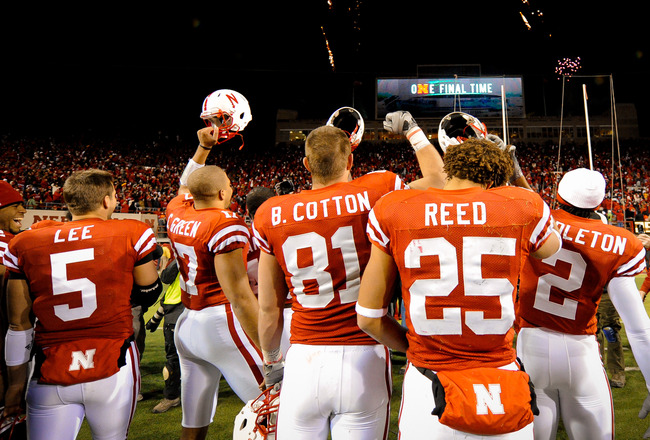 LINCOLN, NE - NOVEMBER 26: Members of the Nebraska Cornhuskers celebrate their Big 12 North chamionship after their game at Memorial Stadium on November 26, 2010 in Lincoln, Nebraska. Nebraska defeated Colorado 45-17. (Photo by Eric Francis/Getty Images)