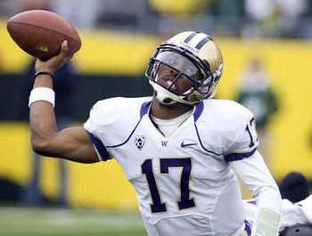 EUGENE, OR - NOVEMBER 06: Quarterback Keith Price #17 of the Washington Huskies throws the ball as he is tackled in the third quarter of the game against the Oregon Ducks at Autzen Stadium on November 6, 2010 in Eugene, Oregon. The Ducks won the game 53-1