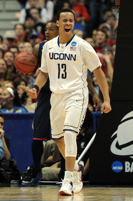 ANAHEIM, CA - MARCH 26:  Shabazz Napier #13 of the Connecticut Huskies reacts after a basket against the Connecticut Huskies during the west regional final of the 2011 NCAA men's basketball tournament at the Honda Center on March 26, 2011 in Anaheim, Cali