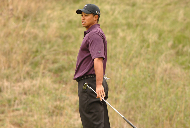 UNITED STATES - DECEMBER 08:  Tiger Woods reacts to a missed putt on the 8th green during the first round of the Target World Challenge Presented by Countrywide at the Sherwood Country Club in Thousand Oaks, California December 8, 2005.  (Photo by Steve G