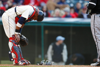 CLEVELAND - APRIL 01: Carlos Santana #41 of the Cleveland Indians has a moment to himself after getting hit near the neck with a pitch against the Chicago White Sox during the Opening Day game on April 1, 2011 at Progressive Field in Cleveland, Ohio.  (Ph