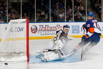 UNIONDALE, NY - MARCH 24:  Goalie Chris Mason #50 of the Atlanta Thrashers makes a save on this breakaway by Michael Grabner #40 of the New York Islanders during the second period of an NHL hockey game at the Nassau Coliseum on March 24, 2011 in Uniondale