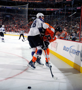 PHILADELPHIA - FEBRUARY 13:  Jarret Stoll #28 of the Los Angeles Kings checking Chris Pronger #20 of the Philadelphia Flyers on February 13, 2011 at the Wells Fargo Center in Philadelphia, Pennsylvania.  (Photo by Lou Capozzola/Getty Images)