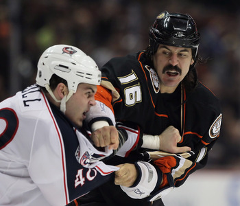 ANAHEIM, CA - JANUARY 07:  George Parros #16 of the Anaheim Ducks throws a punch at Jared Boll #40 of the Columbus Blue Jackets in the first period at the Honda Center on January 7, 2011 in Anaheim, California.  (Photo by Jeff Gross/Getty Images)