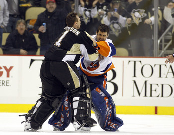 PITTSBURGH, PA - FEBRUARY 02:  Brent Johnson #1 of the Pittsburgh Penguins gets in a left against Rick DiPietro #39 of the New York Islanders at Consol Energy Center on February 2, 2011 in Pittsburgh, Pennsylvania.  The Penguins shut out the Islanders 3-0