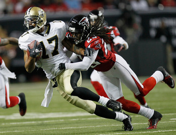 ATLANTA, GA - DECEMBER 27:  Robert Meachem #17 of the New Orleans Saints fights off the tackle of Atlanta Falcons defender Dunta Robinson #23  in the first half during their game at the Georgia Dome on December 27, 2010 in Atlanta, Georgia.  (Photo by Kev