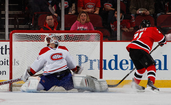 NEWARK, NJ - APRIL 02:  Goalie Carey Price #31 of the Montreal Canadians blocks this penalty shot with his leg as Mattias Tedenby #21 of the New Jersey Devils faked and tried to put it in next to the post during the first period of an NHL hockey game at t