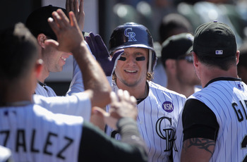 DENVER - SEPTEMBER 06:  Shortstop Troy Tulowitski #2 of the Colorado Rockies is welcomed back to the dugout after his solo home run off of relief pitcher Bill Bray of the Cincinnati Reds in the fifth inning at Coors Field on September 6, 2010 in Denver, C
