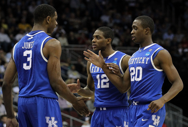 NEWARK, NJ - MARCH 27:  Terrence Jones #3 of the Kentucky Wildcats is congratulated by Brandon Knight #12 and Doron Lamb #20 during the first half of the game against the North Carolina Tar Heels in the east regional final of the 2011 NCAA men's basketbal