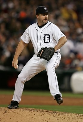 DETROIT - OCTOBER 13:  Todd Jones #59 of the Detroit Tigers pitches against the Oakland Athletics during Game Three of the American League Championship Series October 13, 2006 at Comerica Park in Detroit, Michigan. The Tigers won 3-0 to take a 3-0 series