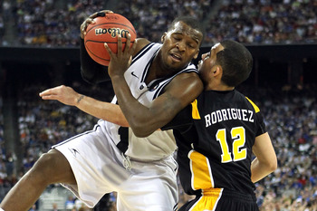 HOUSTON, TX - APRIL 02:  Shelvin Mack #1 of the Butler Bulldogs draws contact against Joey Rodriguez #12 of the Virginia Commonwealth Rams during the National Semifinal game of the 2011 NCAA Division I Men's Basketball Championship at Reliant Stadium on A