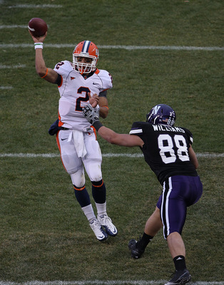 CHICAGO - NOVEMBER 20: Nathan Scheelhaase #2 of the Illinois Fighting Illini passes the ball under pressure from Quentin Williams #88 of the Northwestern Wildcats during a game played at Wrigley Field on November 20, 2010 in Chicago, Illinois. (Photo by J