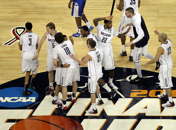 HOUSTON, TX - APRIL 02:  The Connecticut Huskies celebrate after defeating the Kentucky Wildcats during the National Semifinal game of the 2011 NCAA Division I Men's Basketball Championship at Reliant Stadium on April 2, 2011 in Houston, Texas.  (Photo by