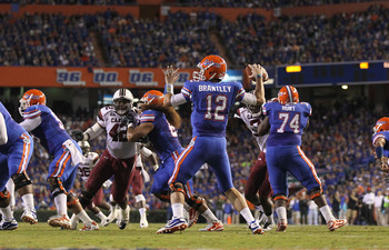 GAINESVILLE, FL - NOVEMBER 13:  John Brantley #12 of the Florida Gators passes during a game against the South Carolina Gamecocks at Ben Hill Griffin Stadium on November 13, 2010 in Gainesville, Florida.  (Photo by Mike Ehrmann/Getty Images)