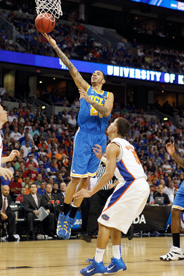 TAMPA, FL - MARCH 19:  Tyler Honeycutt #23 of the UCLA Bruins drives for a shot attempt against Scottie Wilbekin #5 of the Florida Gators during the third round of the 2011 NCAA men's basketball tournament at St. Pete Times Forum on March 19, 2011 in Tamp