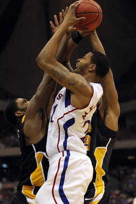 SAN ANTONIO, TX - MARCH 27:  Markieff Morris #21 of the Kansas Jayhawks shoots against Jamie Skeen #21 of the Virginia Commonwealth Rams during the southwest regional final of the 2011 NCAA men's basketball tournament at the Alamodome on March 27, 2011 in