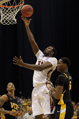 SAN ANTONIO, TX - MARCH 25:  Chris Singleton #31 of the Florida State Seminoles puts up a shot against Juvonte Reddic #5 of the Virginia Commonwealth Rams during the southwest regional of the 2011 NCAA men's basketball tournament at the Alamodome on March