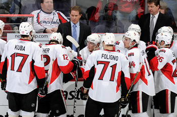 WASHINGTON, DC - JANUARY 16:  Head coach Cory Clouston of the Ottawa Senators talks to his team during a timeout in the game against the Washington Capitals at the Verizon Center on January 16, 2011 in Washington, DC.  (Photo by Greg Fiume/Getty Images)