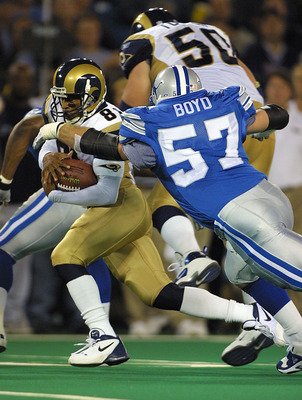 08 Oct 2001:  Az-Zahir Hakim #81 of the St.Louis Rams tries to elude Stephen Boyd #57 of the Detroit Lions during the game at the Pontiac Silverdome in Pontiac, Michigan. The Rams defeated the Lions 35-0. DIGITAL IMAGE. Mandatory Credit: Tom Pidgeon/Allsp