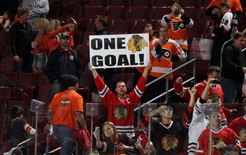 PHILADELPHIA - JUNE 09:  A fan of the Chicago Blackhawks celebrates after his team defeated the Philadelphia Flyers to win the Stanley Cup in Game Six of the 2010 NHL Stanley Cup Final at the Wachovia Center on June 9, 2010 in Philadelphia, Pennsylvania.