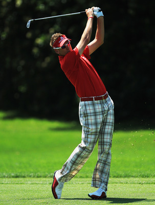 ORLANDO, FL - MARCH 24:  Ian Poulter of England plays his second shot at the 1st hole during the first round of the 2011 Arnold Palmer Invitational presented by Mastercard at the Bay Hill Lodge and Country Club on March 24, 2011 in Orlando, Florida.  (Pho