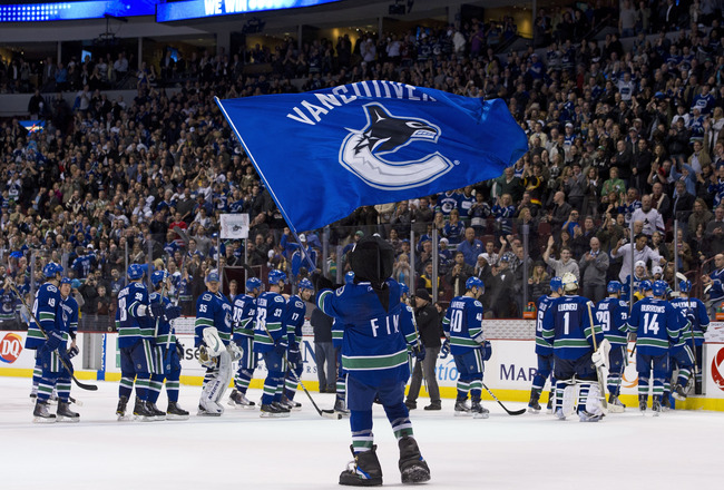 VANCOUVER, CANADA - MARCH 31: Vancouver Canucks mascot Fin waves a team flag after the Vancouver Canucks defeated the Los Angeles Kings in NHL action on March 31, 2011 at Rogers Arena in Vancouver, BC, Canada.  (Photo by Rich Lam/Getty Images)