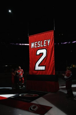 RALEIGH, NC - FEBRUARY 17: Glen Wesley #2 of the Carolina Hurricanes watches as his jersey is raised to the rafters during a ceremony before the game against the Boston Bruins on February 17, 2009 at RBC Center in Raleigh, North Carolina. (Photo by Kevin