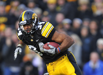 IOWA CITY, IA - NOVEMBER 20:  Running back Marcus Coker #34 of the University of Iowa Hawkeyes is tackled by linebacker Ross Homan #51 of the Ohio State Buckeyes during the first half of play at Kinnick Stadium on November 20, 2010 in Iowa City, Iowa. Ohi