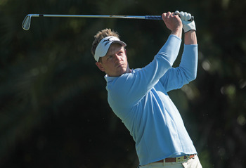 DORAL, FL - MARCH 11:  Luke Donald of England watches his tee shot on the 15th hole during the completion of the first round of the 2011 WGC- Cadillac Championship at the TPC Blue Monster at the Doral Golf Resort and Spa on March 11, 2011 in Doral, Florid
