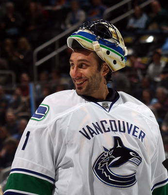 ATLANTA, GA - MARCH 25: Roberto Luongo #1 of the Vancouver Canucks responds to a comment by Dustin Byfuglien #33 of the Atlanta Thrashers during a timeout at the Philips Arena on March 25, 2011 in Atlanta, Georgia.  (Photo by Bruce Bennett/Getty Images)