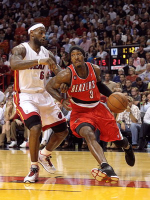 MIAMI, FL - MARCH 08:  Gerald Wallace #3 of the Portland Trail Blazers drives by LeBron James #6 of the Miami Heat during a game at American Airlines Arena on March 8, 2011 in Miami, Florida. NOTE TO USER: User expressly acknowledges and agrees that, by d