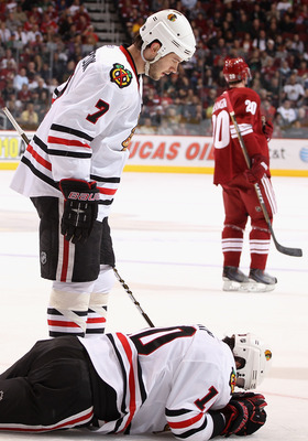 GLENDALE, AZ - MARCH 20:  Patrick Sharp #10 of the Chicago Blackhawks lays on the ice after an injury as Brent Seabrook #7 looks down during the first period of the NHL game against the Phoenix Coyotes at Jobing.com Arena on March 20, 2011 in Glendale, Ar