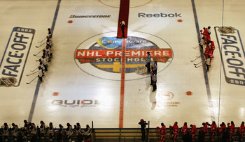 STOCKHOLM, SWEDEN - OCTOBER 02:  Players from Detroit Red Wings and St. Louis Blues line up for the national anthems of United States and Sweden before the start of the 2009 Compuware NHL Premiere Stockholm match between Detroit Red Wings and St. Louis Bl