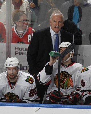 SUNRISE, FL - MARCH 8: Head coach Joel Quenneville of the Chicago Blackhawks watches third period action against the Florida Panthers on March 8, 2011 at the BankAtlantic Center in Sunrise, Florida. The Panthers defeated the Blackhawks 3-2. (Photo by Joel