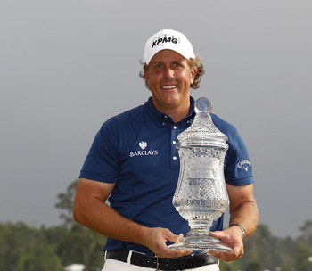 HUMBLE, TX - APRIL 03:  Phil Mickelson holds the trophy after winning the Shell Houston Open at Redstone Golf Club on April 3, 2011 in Humble, Texas.  (Photo by Michael Cohen/Getty Images)