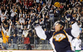 NASHVILLE, TN - FEBRUARY 17:  Fans celebrate after a goal is scored by Mike Fisher of the Nashville Predators on February 17, 2011 at the Bridgestone Arena in Nashville, Tennessee.  (Photo by Frederick Breedon/Getty Images)