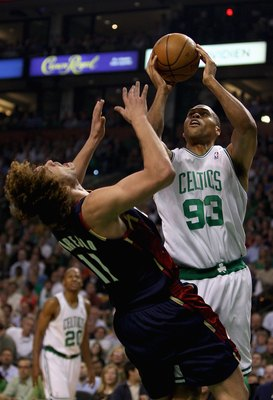 BOSTON - MAY 8:  P.J. Brown #93 of the Boston Celtics collides with Anderson Varejao #17 of the Cleveland Cavaliers in Game Two of the Eastern Conference Semifinals during the 2008 NBA Playoffs on May 8, 2008 at the TD Banknorth Garden in Boston, Massachu