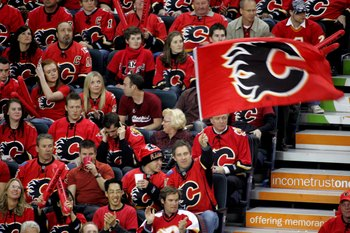 CALGARY, CANADA - APRIL 15:  Fans of the Calgary Flames form a'Seas of Red' to support their team against the San Jose Sharks during game four of the Western Conference Quarterfinals of the 2008 NHL Stanley Cup Playoffs at Pengrowth Saddledome on April 15