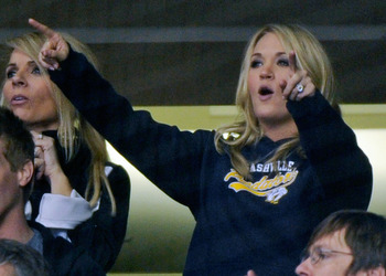NASHVILLE, TN - FEBRUARY 17:  Country music singer Carrie Underwood celebrates after a goal by the Nashville Predators against the Vancouver Canucks on February 17, 2011 at the Bridgestone Arena in Nashville, Tennessee.  (Photo by Frederick Breedon/Getty