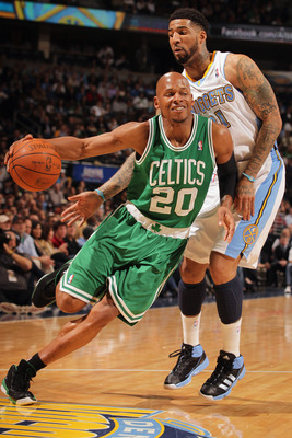 DENVER, CO - FEBRUARY 24:  Ray Allen #20 of the Boston Celtics drives around Wilson Chandler #21 of the Denver Nuggets during NBA action at the Pepsi Center on February 24, 2011 in Denver, Colorado. NOTE TO USER: User expressly acknowledges and agrees tha
