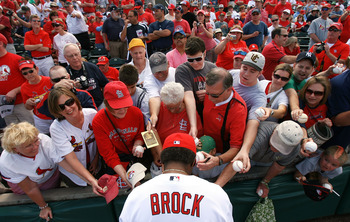 JUPITER, FL - MARCH 10:  Hall-of-Famer Lou Brock #20 of the St Louis Cardinals signs autographs for fans before taking on the Washington Nationals at Roger Dean Stadium on March 10, 2010 in Jupiter, Florida.  (Photo by Doug Benc/Getty Images)