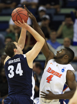 NEW ORLEANS, LA - MARCH 24:  Noah Hartsock #34 of the Brigham Young Cougars shoots over Patric Young #4 of the Florida Gators during the Southeast regional of the 2011 NCAA men's basketball tournament at New Orleans Arena on March 24, 2011 in New Orleans,