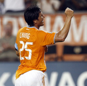 HOUSTON - SEPTEMBER 18:  Brian Ching #25 of the Houston Dynamo celebrates after scoring on a header in the 18th minute against Toronto FC at Robertson Stadium on September 18, 2010 in Houston, Texas.  (Photo by Bob Levey/Getty Images)